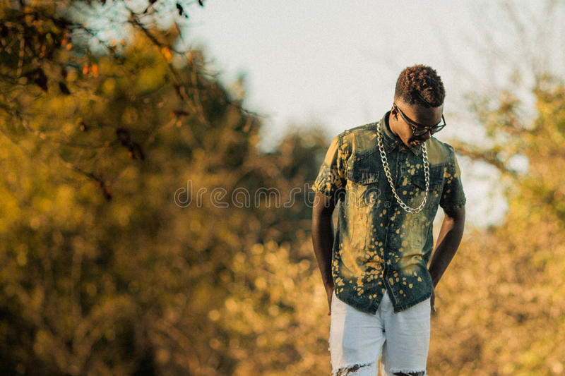 Teenage Male Model. One african american male posing for high school senior portraits royalty free stock photos