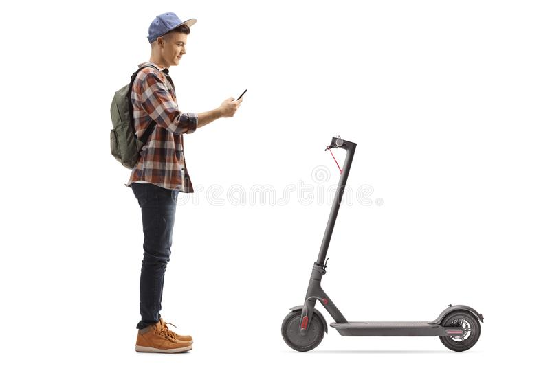 Teenage male student renting an electric scooter with a mobile phone application stock images