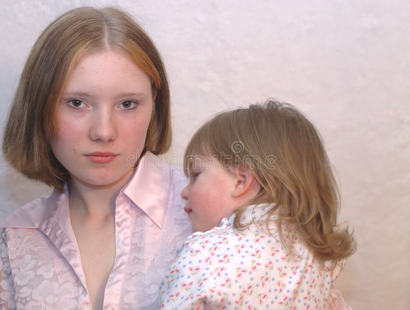 Teenage Mother / Sisters stock photos