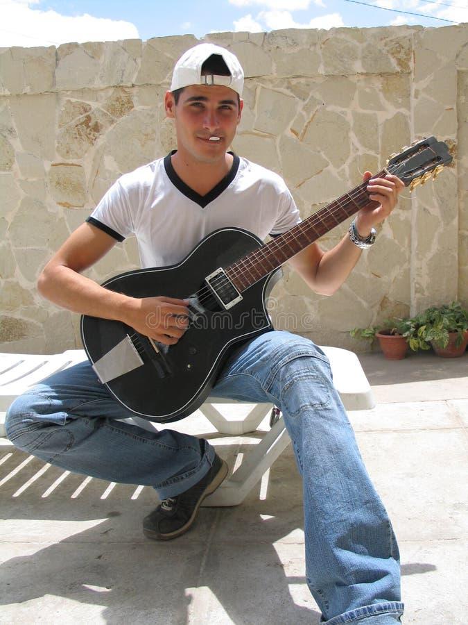 Teenage playing guitar stock photos