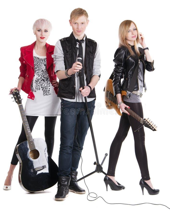 Teenage rock band. Against white background stock images