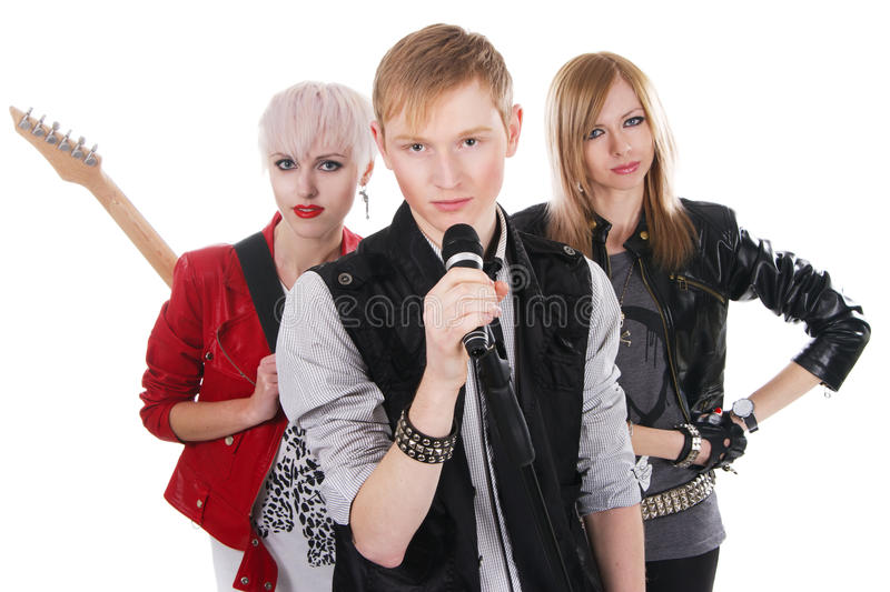 Teenage rock band. Against white background royalty free stock photography