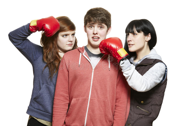Teenage siblings fighting with boxing gloves royalty free stock photos