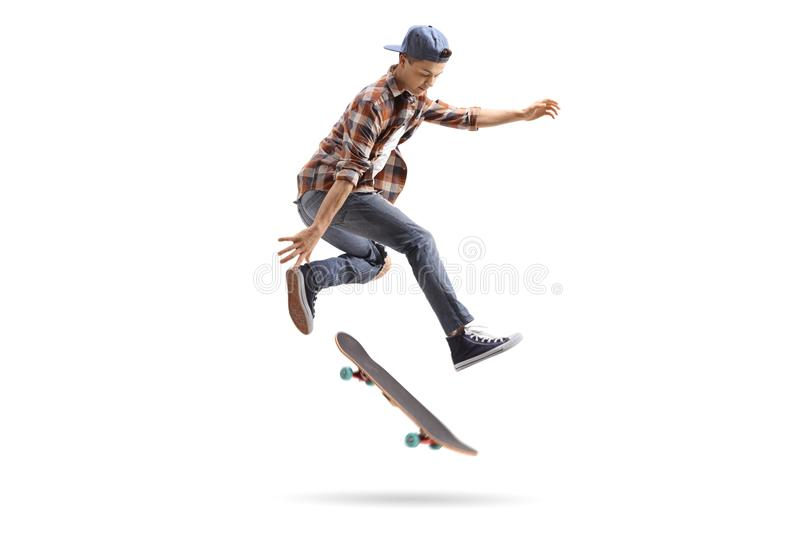Teenage skater performing a trick with a skateboard royalty free stock image