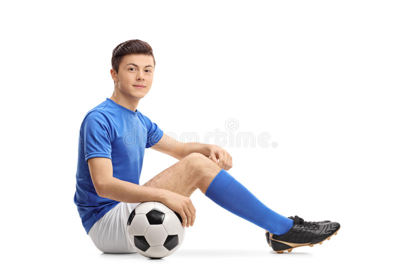 Teenage soccer player sitting on the floor stock photos