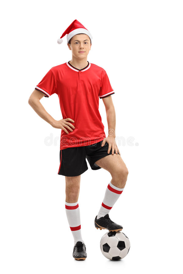 Teenage soccer player wearing a Christmas hat royalty free stock photography