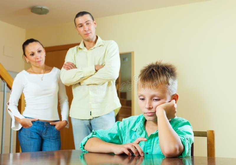 Teenage son and parents having quarrel royalty free stock photos
