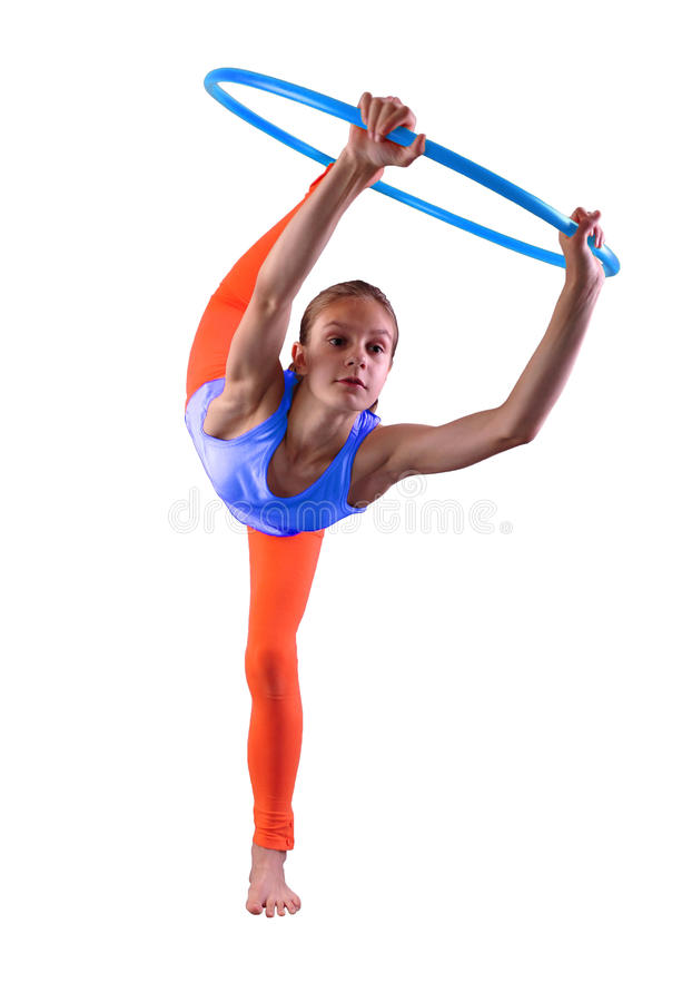 Teenage sportive girl is doing exercises with hula hoop t on grey background. Having fun playing game . Sport healthy lifestyle co royalty free stock images