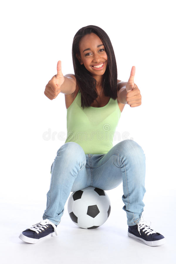 Teenage sports girl two thumbs up happy success royalty free stock photography