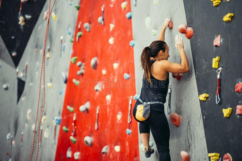 Teenage girl in a free climbing wall royalty free stock photo