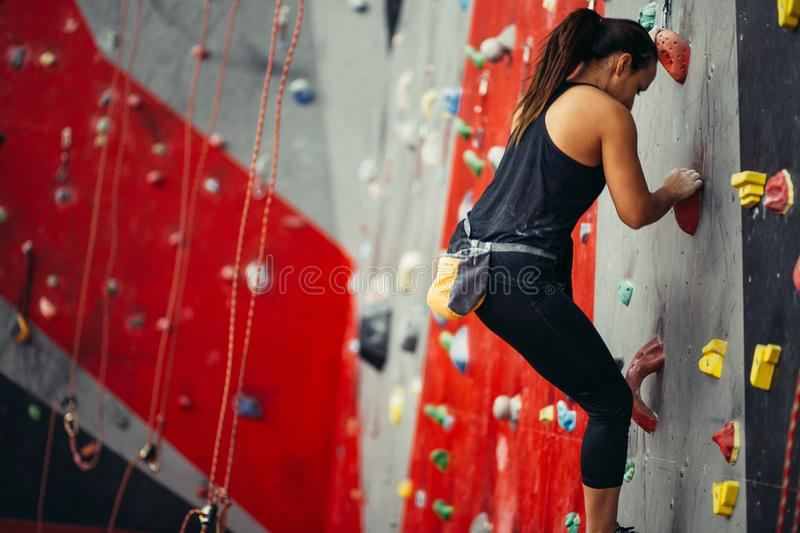 Teenage girl in a free climbing wall royalty free stock photos