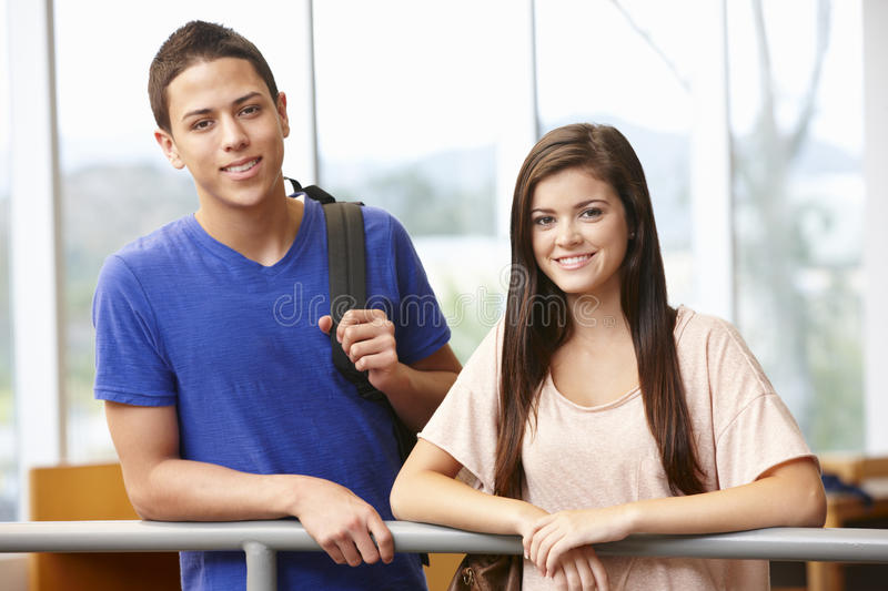 Teenage student girl and boy indoors royalty free stock image