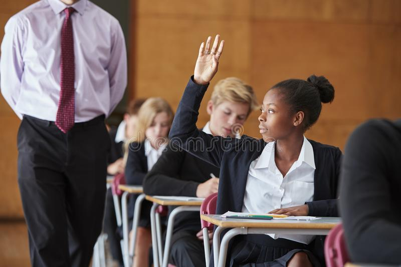 Teenage Student Sitting Examination Asking Teacher Question royalty free stock photography