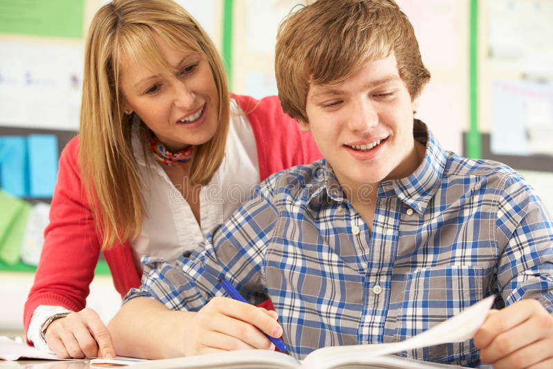 Teenage Student Studying With Teacher royalty free stock photography