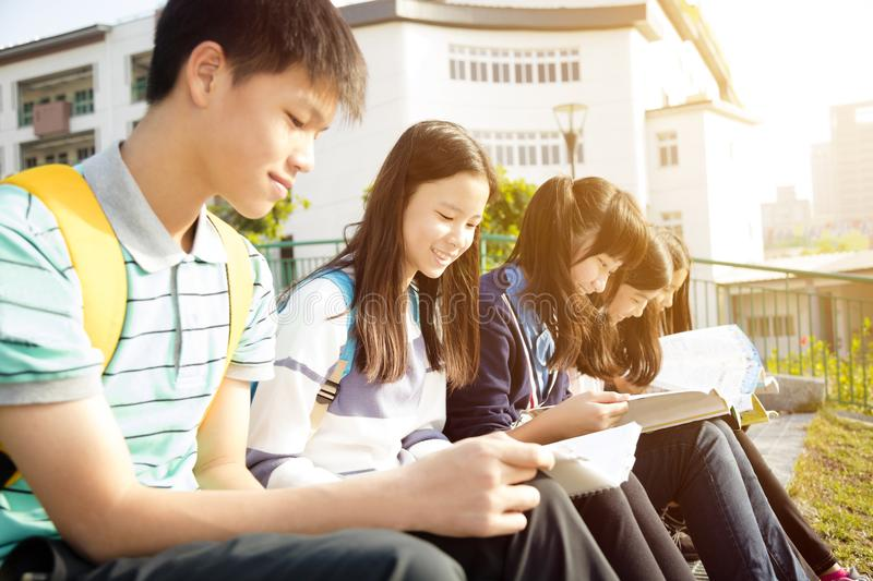 Teenage Students sitting and studying stock photos
