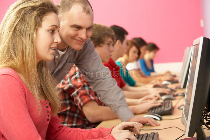 Teenage Students In IT Class Using Computers royalty free stock photography