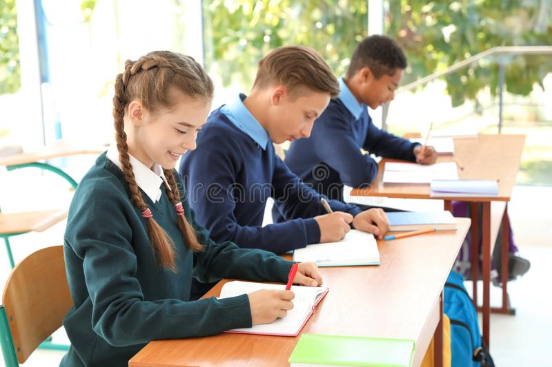 Teenage students in classroom royalty free stock photos