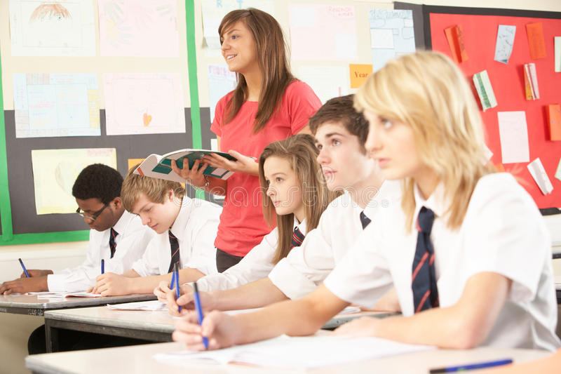 Download Teenage Students Studying In Classroom Stock Photo - Image: 18034218
