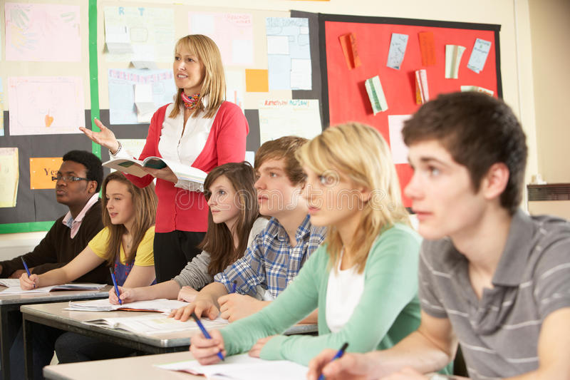 Teenage Students Studying In Classroom stock image