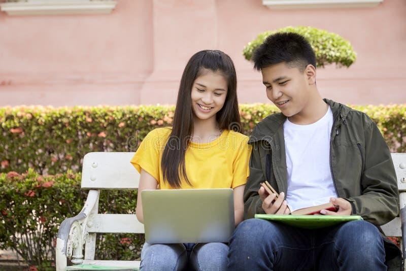 Teenage students work school job on laptop royalty free stock photography