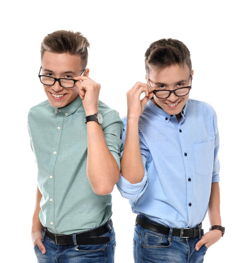 Teenage twin brothers with glasses stock photo