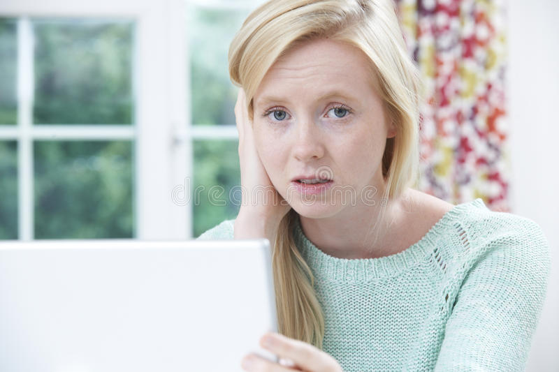 Teenage Victim Of Online Bullying With Laptop. Portrait Of Teenage Victim Of Online Bullying With Laptop stock photo