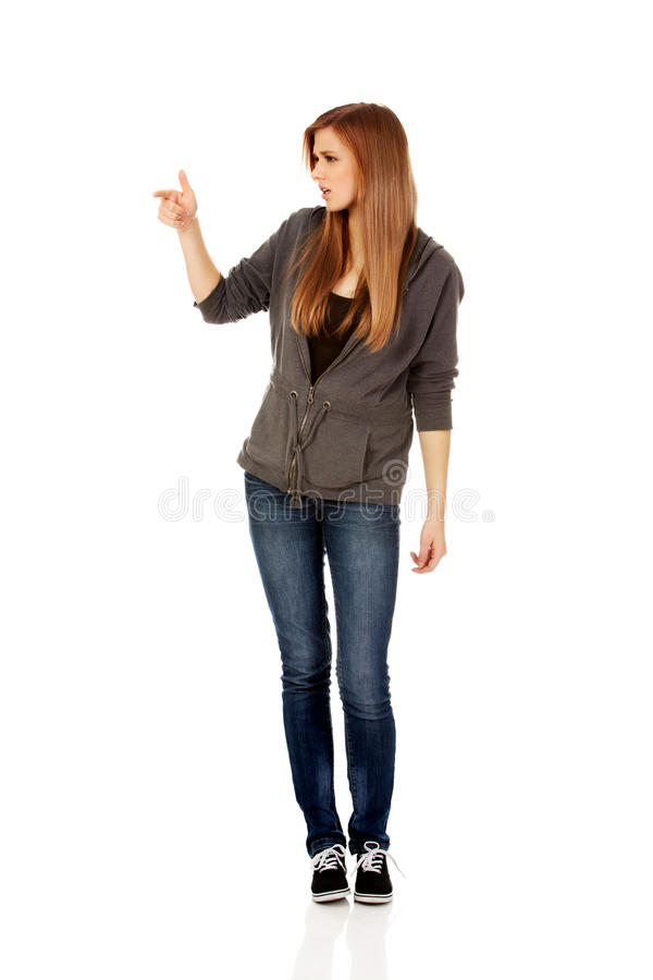 Teenage woman threatens someone the finger.  royalty free stock image