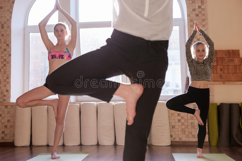 Teenage yoga class. Sport for children royalty free stock photography