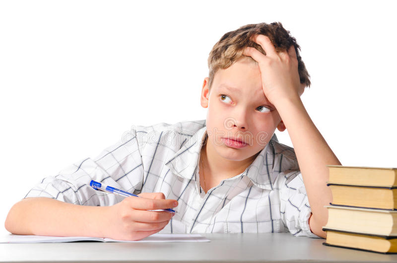Teenager. Boy is sitting at table on white background stock photography