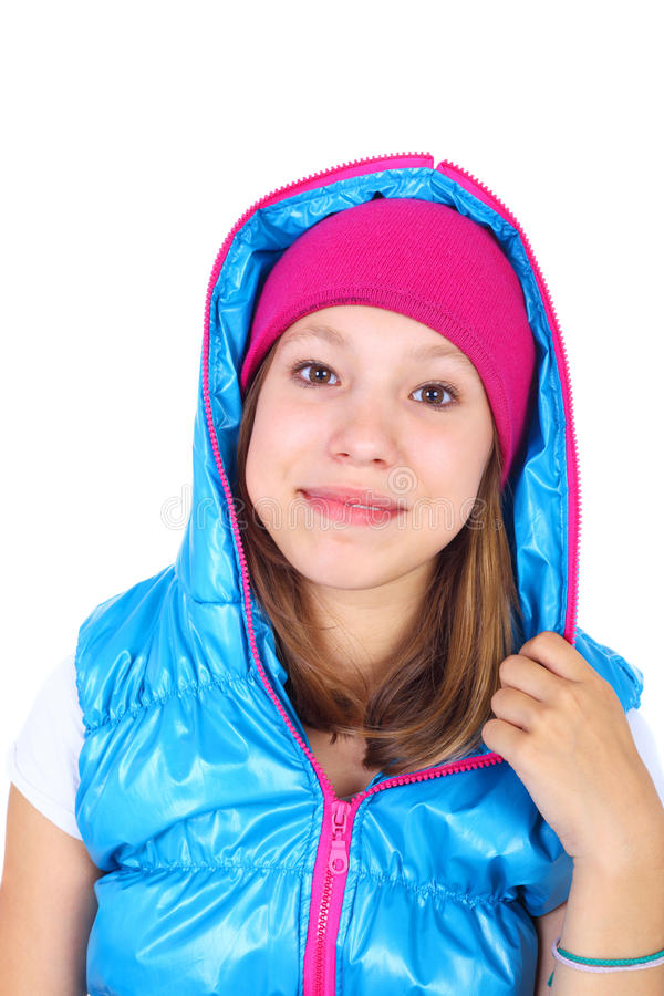 Teenager. Pretty teenage smiling girl wearing vest closeup stock images