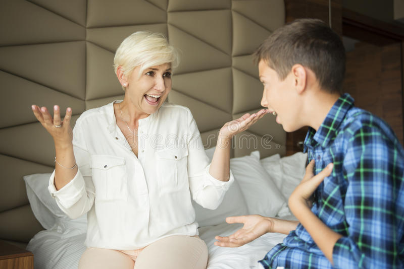 A teenager arguing with his mother royalty free stock photography