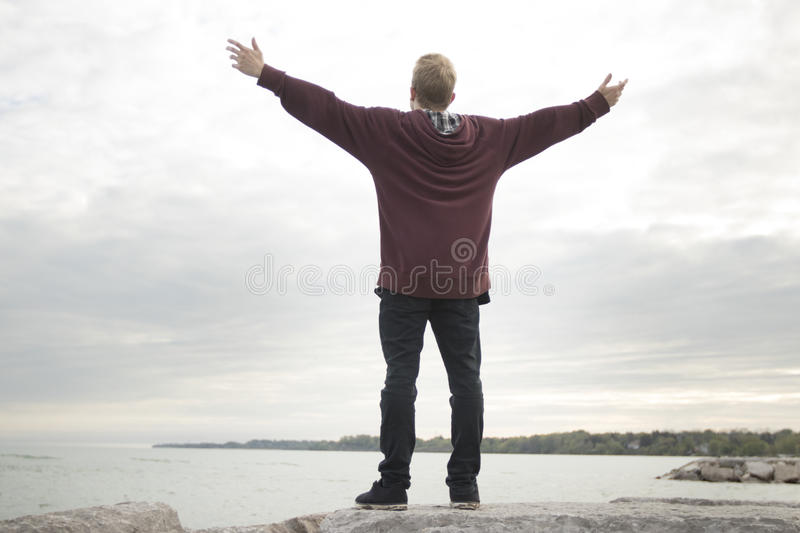 Teenager with arms in air royalty free stock image
