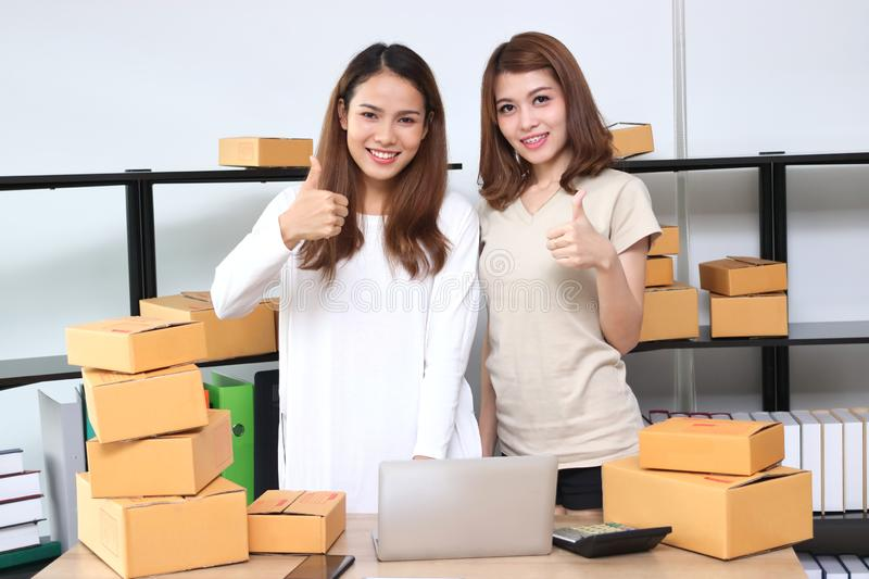 Teenager Asian entrepreneur owner working together at workplace at home. Start up small business royalty free stock images