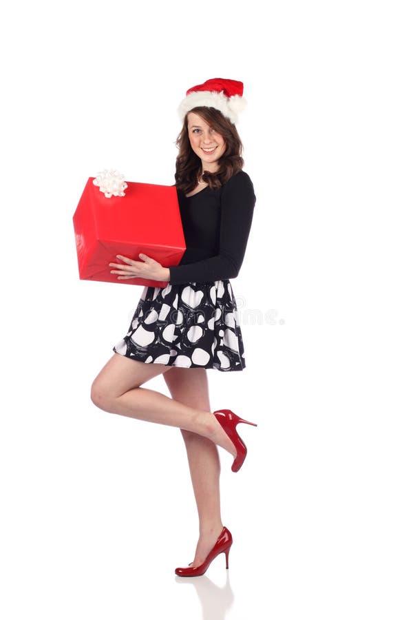 Teenager attraente con il presente fotografia stock libera da diritti