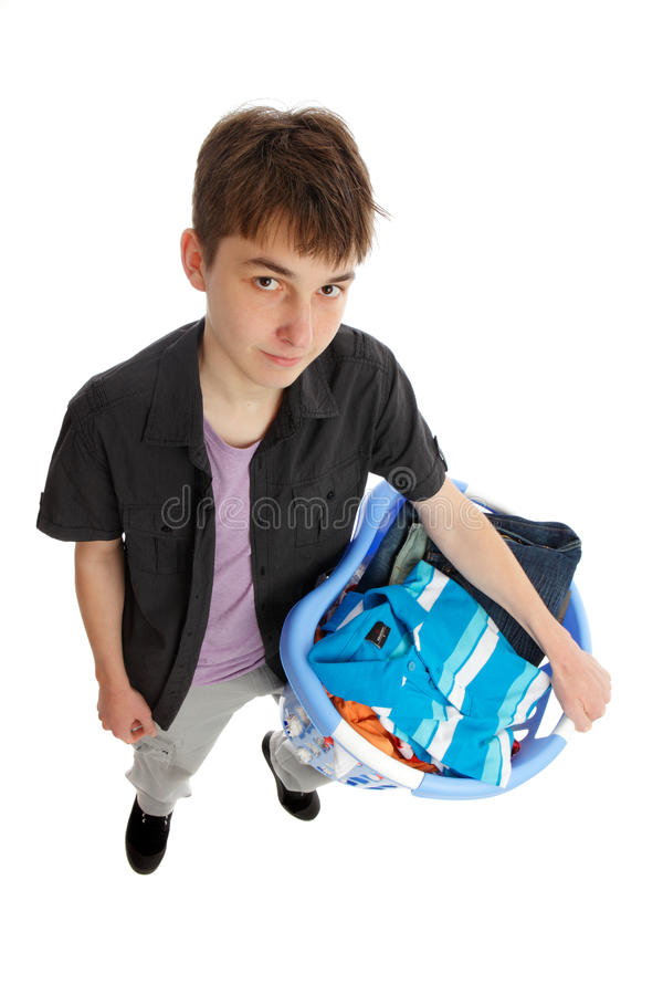 Teenager with basket of clothing. A teenager holds a basket of clothing. White background royalty free stock photos