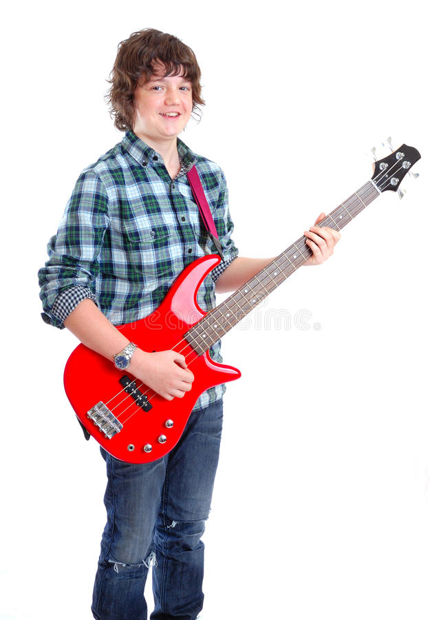 Teenager on Bass guitar stock photo