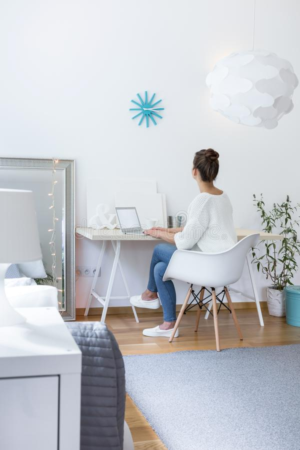Teenager in beautiful white room royalty free stock images