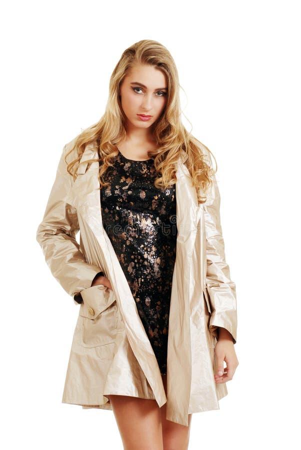 Teenager in a beige rain coat royalty free stock image