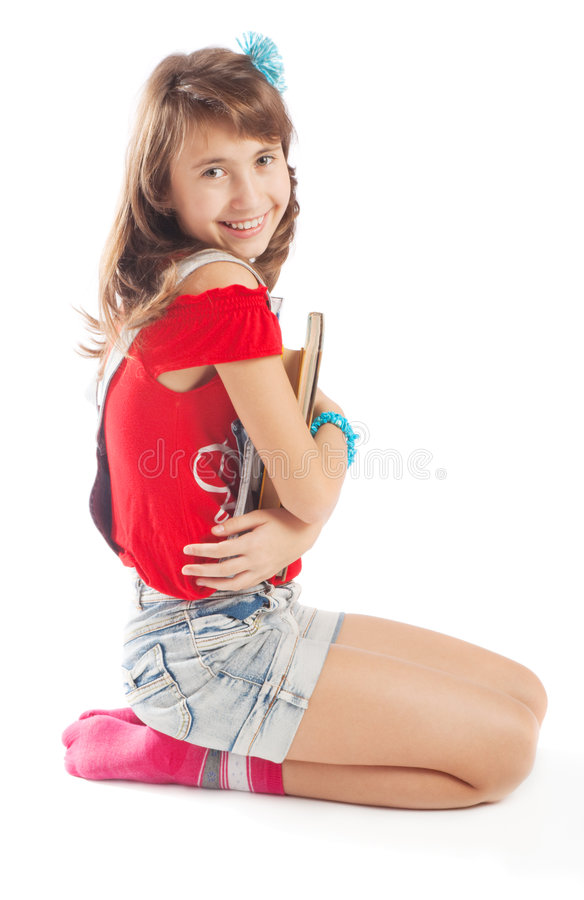 Teenager with books stock photo