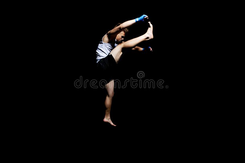 Teenager boxing in studio. The portrait of teenager boy training and boxing royalty free stock photo