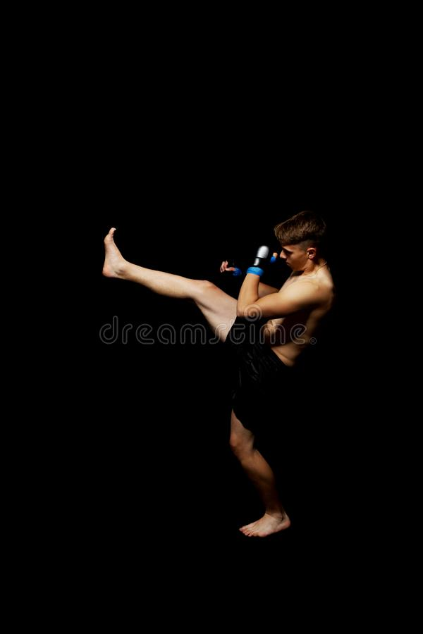 Teenager boxing in studio. The portrait of teenager boy training and boxing royalty free stock photos