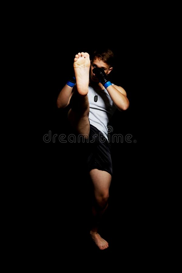 Teenager boxing in studio. The portrait of teenager boy training and boxing stock image