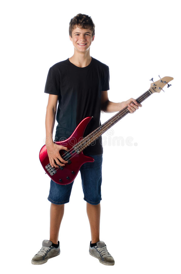 Teenager boy with bass guitar smiling royalty free stock images