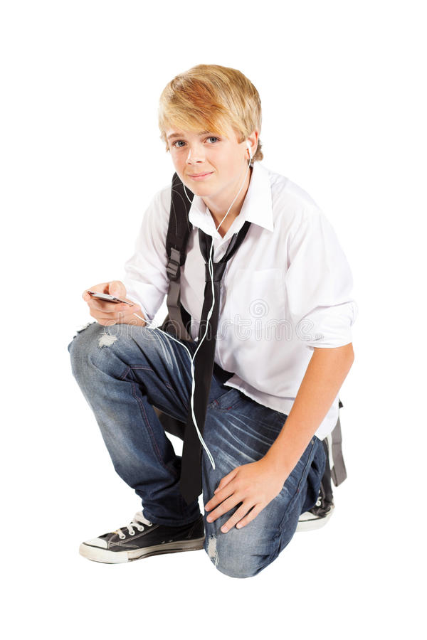 Teenager boy with cell phone. Or mp3 player royalty free stock photography