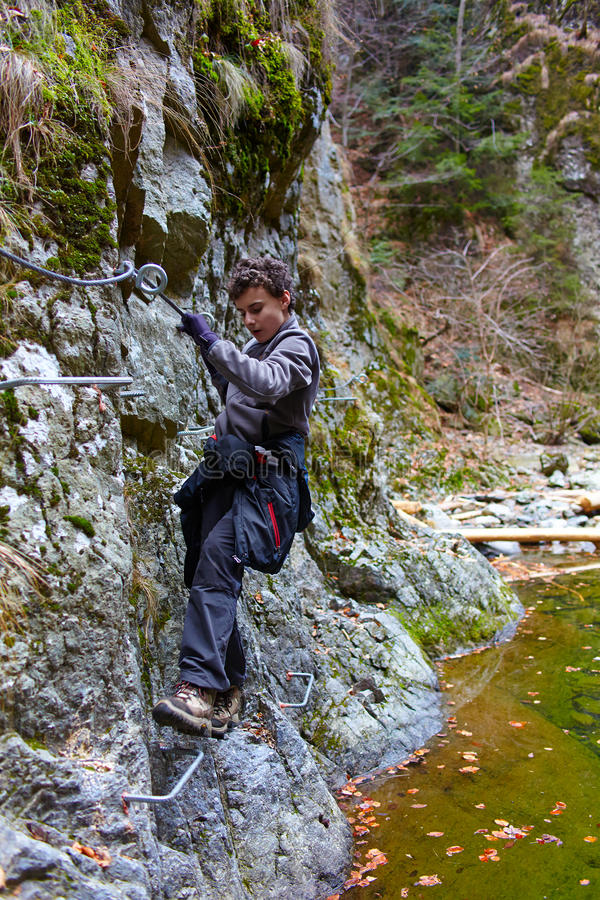 Download Teenager boy climbing stock image. Image of achievement - 37503793