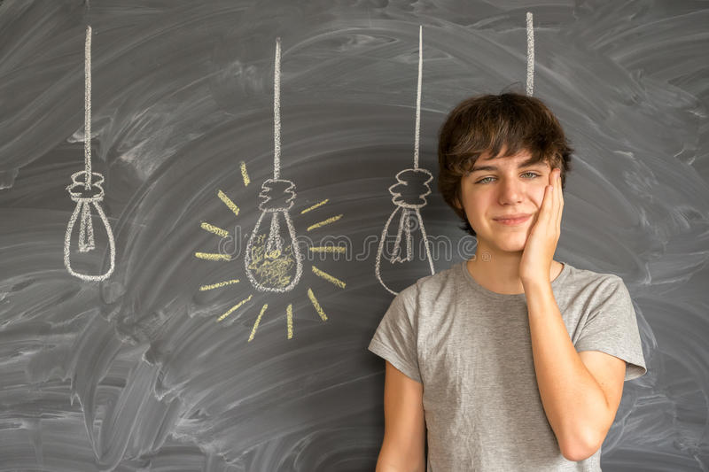Teenager boy getting an idea royalty free stock image