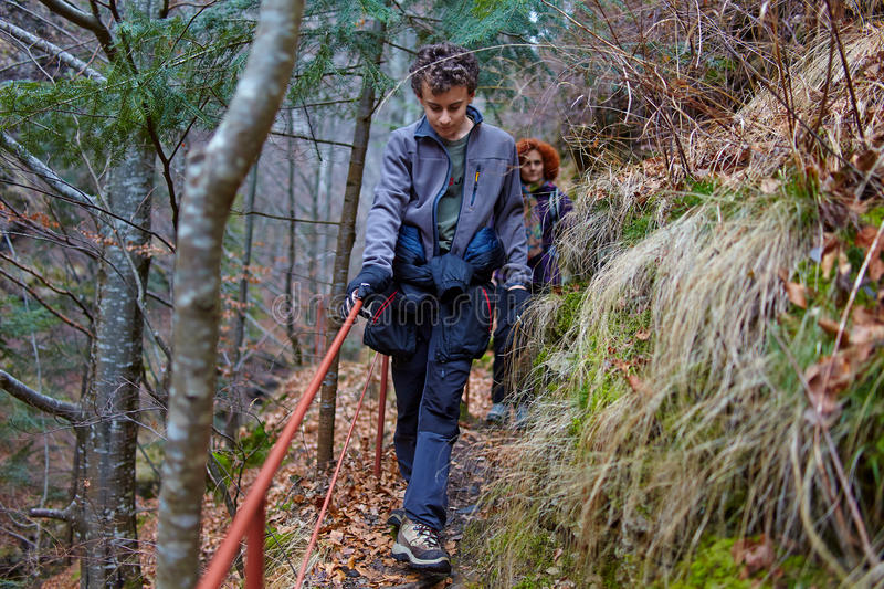 Teenager boy and his mother hiking