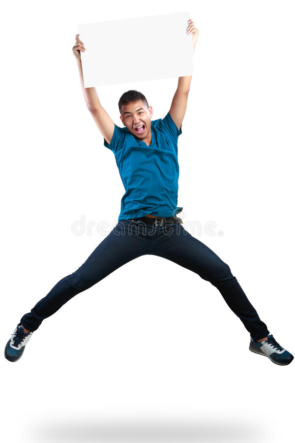 Teenager boy jumping and holding blank paper. Isolated over white royalty free stock photography