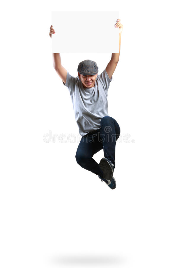 Teenager boy jumping and holding blank paper. Isolated over white royalty free stock images