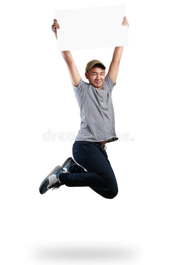 Teenager boy jumping and holding blank paper. Isolated over white stock photography